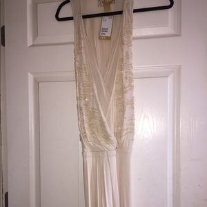 H&M cream floor length dress. Beaded front. NWT.